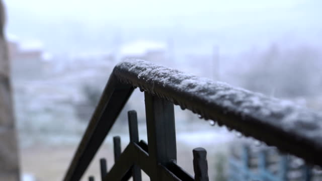 view of hand railing covered with snow. close up. snowy weather - parapetto barriera video stock e b–roll