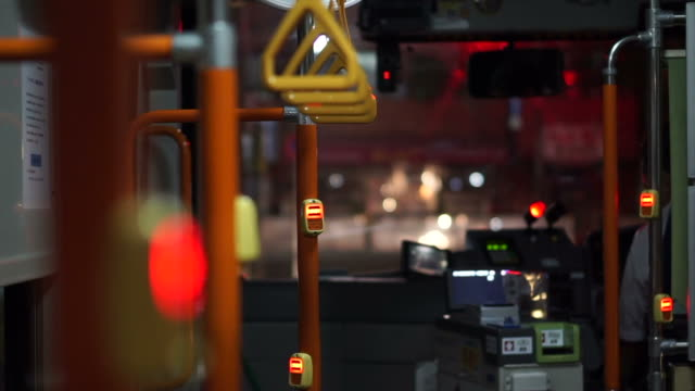 View of handle inside the night city bus. Abstract public transportation in Asia. video