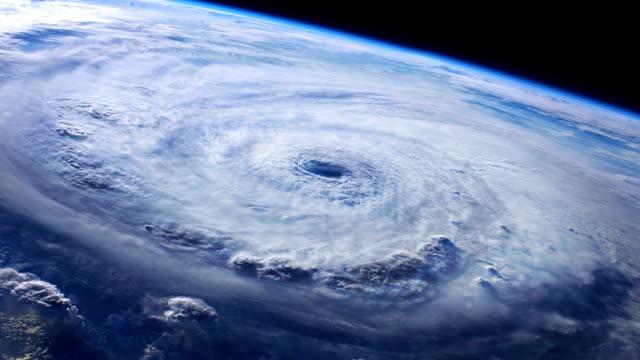 view of hurricane from orbit - uragano video stock e b–roll