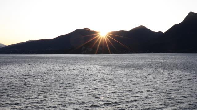 vídeos de stock e filmes b-roll de view of lake maggiore at sunrise - lago maggiore