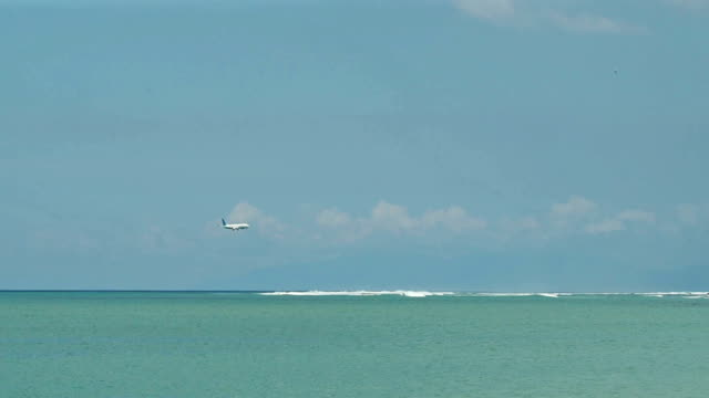View of Landing Airplane from Jimbaran Beach, Bali video