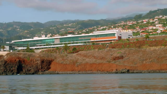 View of Madeira airport building. View from board of sailing yacht video