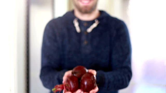 View of man hands holding beetroots video