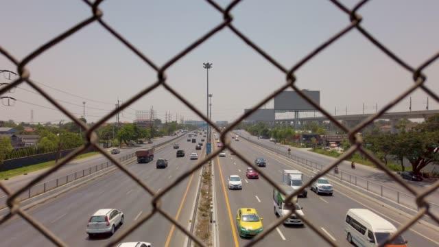 View of Motorway behind fence