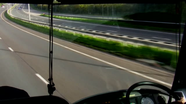 View of motorway through the moving bus windscreen video