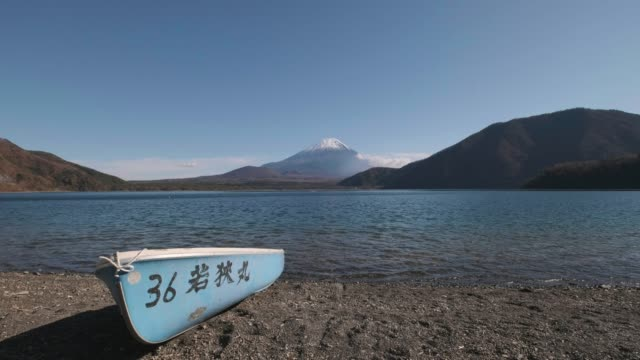 view of mount fuji and row boat from lake motosu, yamanashi prefecture, japan - lakeshore stock videos & royalty-free footage