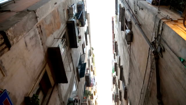 View of narrow passage between high walls of houses in Naples street, Italy video