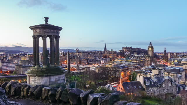 View of old town Edinburgh at twilight Time lapse view of old town Edinburgh at twilight scotland stock videos & royalty-free footage