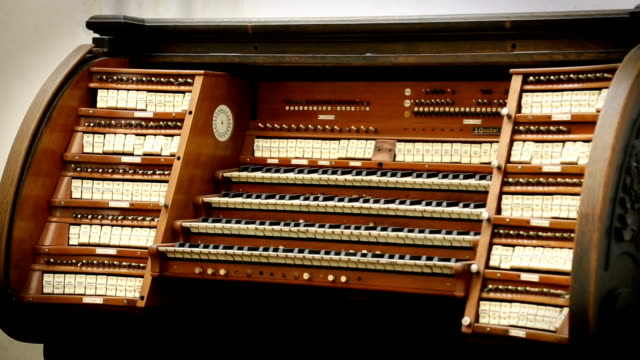 View of old wooden organ standing in the church, religious music, melody video