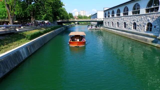 View of orange boat on Ljubljanica river video
