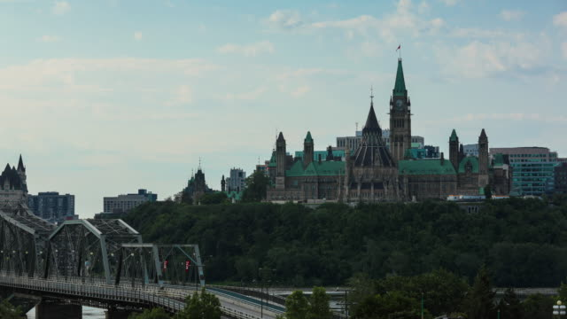 view of parliament hill from ottawa river, canada - canada travel stock videos and b-roll footage