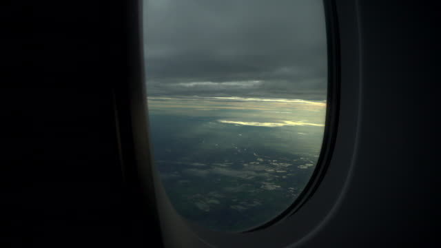 View of passing clouds from an airplane window