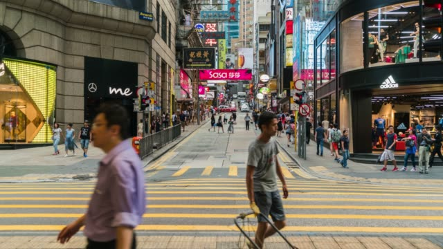 View of people crossing on the streets in the commercial district in Hong Kong.