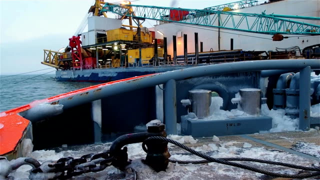 View of pipelayaer with crane from platform View of pipelayaer with crane from platform in sea gas pipe stock videos & royalty-free footage