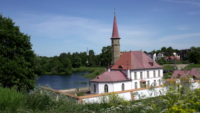 View of Priory Palace or fortress in Gatchina on southeast shore of Black Lake View of Priory Palace or fortress in Gatchina on southeast shore of Black Lake southeast stock videos & royalty-free footage