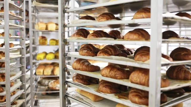 view of rack trolley with various baked bread - francuska kuchnia filmów i materiałów b-roll