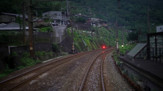 4k view of rails train in jungle and mountain. trip countryside at taiwan - albero tropicale video stock e b–roll