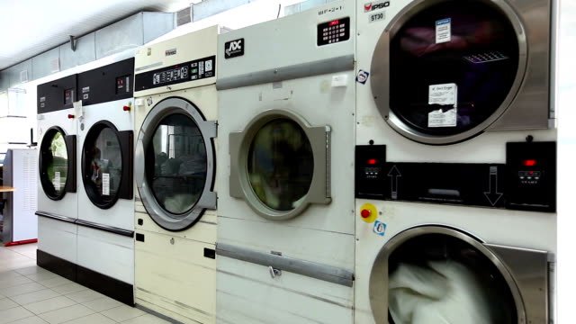 View of running washing machines in laundry room video
