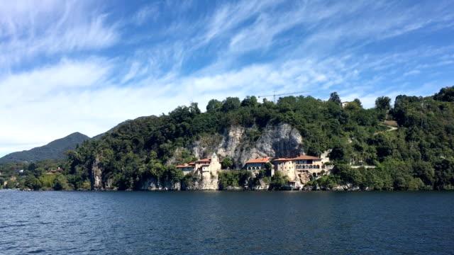 vídeos de stock e filmes b-roll de view of santa caterina from the water - lago maggiore