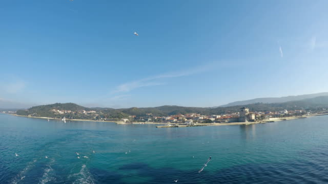 view of seagull birds fly with phospfori tower in ouranopolis, athos peninsula, mount athos, chalkidiki, greece at background - greek architecture stock videos & royalty-free footage
