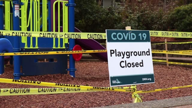 View of sign Playground Closed due to COVID-19(Coronavirus) in Panorama Park