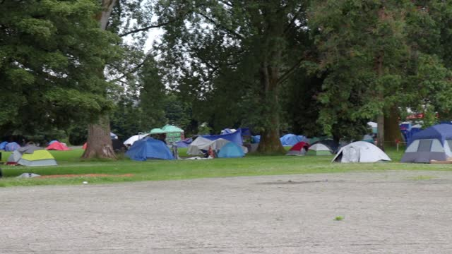 View of Strathcona Park in downtown Vancouver full of tents and homeless people
