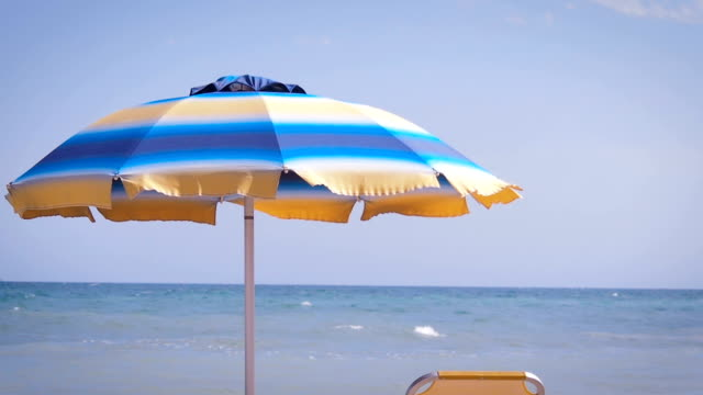 View of sun bed and beach umbrella.