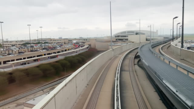 View of the Airport Terminal and Surrounding Roads from the Train at Dallas/Fort Worth International Airport on an Overcast Day