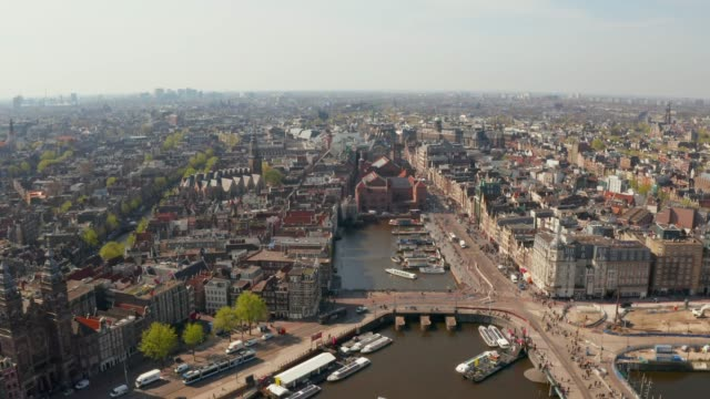 view of the amsterdam central station. - amsterdam video stock e b–roll