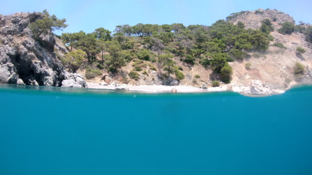 view of the beach from the sea. - fethiye video stock e b–roll