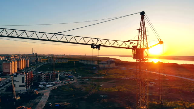 View of the construction site. Several cranes are on a site, working.