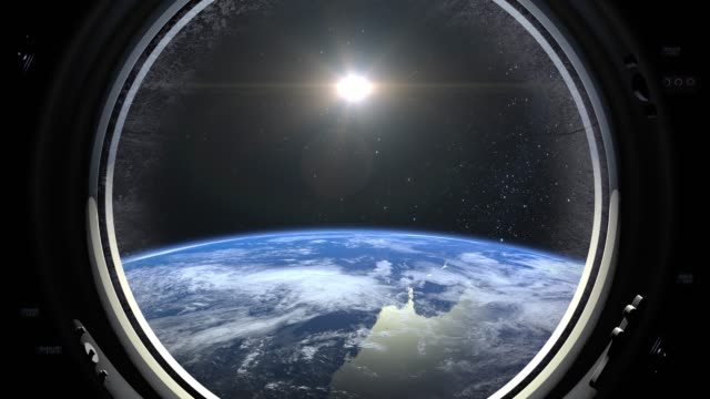 a view of the earth through the big porthole of a spaceship. international space station is orbiting the earth. realistic atmosphere. 3d volumetric clouds. space. iss. 4k. - nieważkość filmów i materiałów b-roll