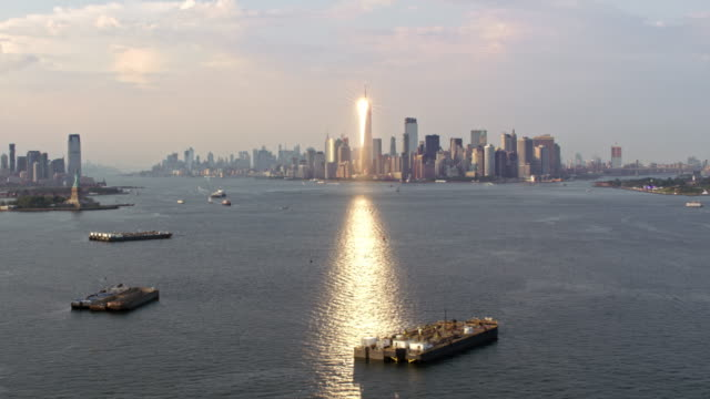 AERIAL View of the Freedom Tower in NYC reflecting the sun