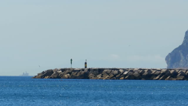 View of the Lighthouse by the Sea near the Rock of Gibraltar. Spain video