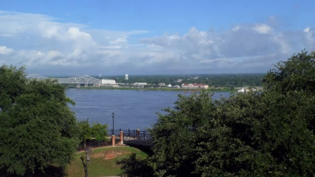 View Of The Mississippi River With Bridge In Natchez View of the Mississippi river in Natchez, Mississippi, United States of America. Natural American landscape in the deep south country geographic area stock videos & royalty-free footage