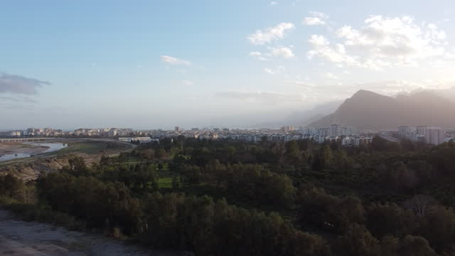 View of the mountain, city and river valley from right to left by drone.