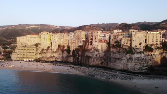 view of the old town of tropea in italy at sunset from drone - video di tropea video stock e b–roll