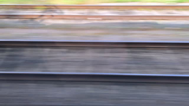 View of the rails during the movement of a high-speed train