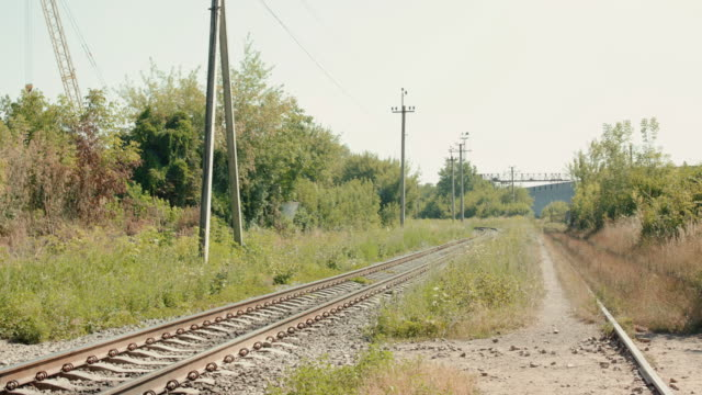 View of the railways out of town in sunny summer day video