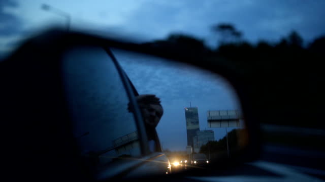 View of the road in the rear view mirror