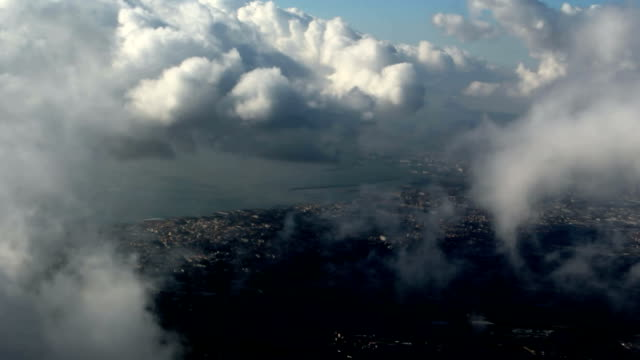 View of the seaside town through the clouds video