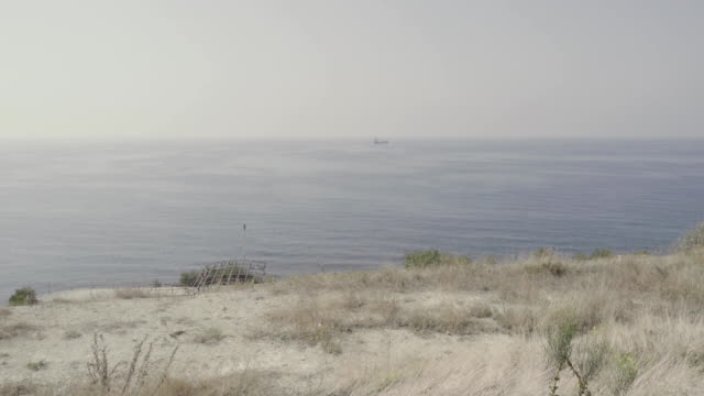 View of the ship in the sea from the shore video