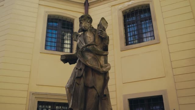 view of the statue of sage with a book in his hands on the background of urban architecture. - renaissance architecture stock videos & royalty-free footage