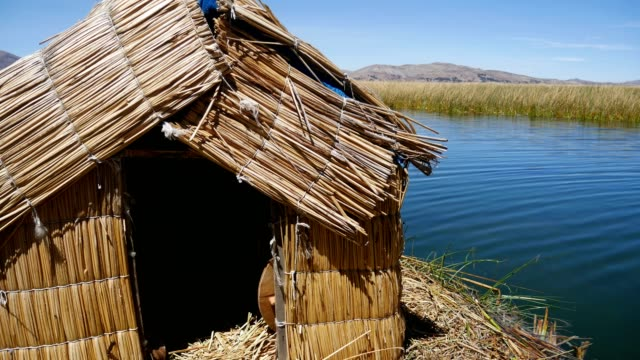 View of the Uros floating reed islands with boats, mysterious Lake Titicaca, Puno Region, Peru video