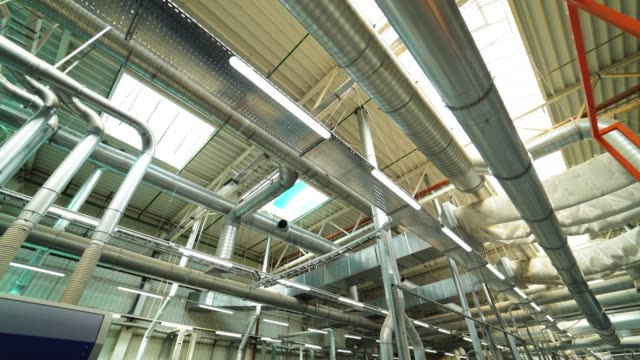 view of the ventilation system of the parquet factory. - canale video stock e b–roll