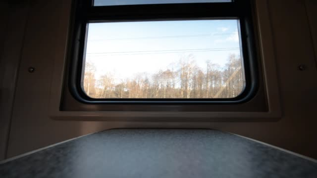 View of the window of a moving passenger train. - vídeo
