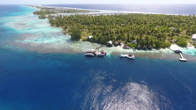 AERIAL view of tropical lagoon and fishing village  pacific islands stock videos & royalty-free footage