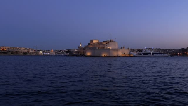 view of Valletta in the afternoon, the illuminated city and the calm blue sea video