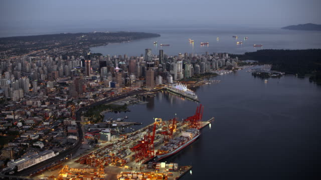 AERIAL View of Vancouver from above the Vancouver Harbour at dusk Aerial shot above the Vancouver Harbour at dusk. Shot in Canada. vancouver canada stock videos & royalty-free footage