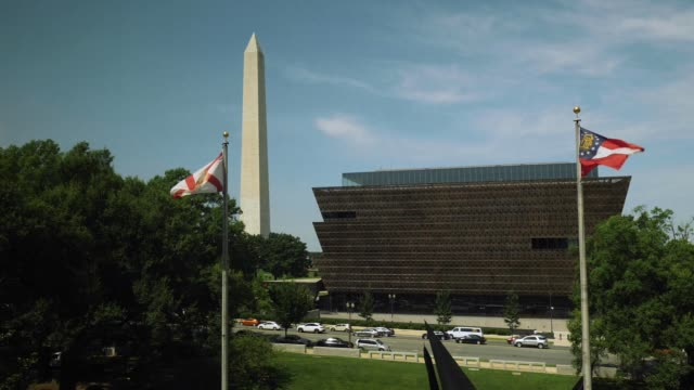 view of washington monument and african american museum - museo video stock e b–roll
